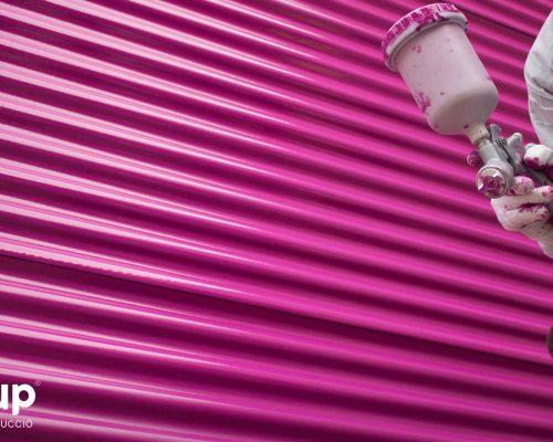 02 detalle rotulación nave industrial aluminera pintura industrial torre gran formato operario ingrup estudi diseno construccion retail granollers barcelona