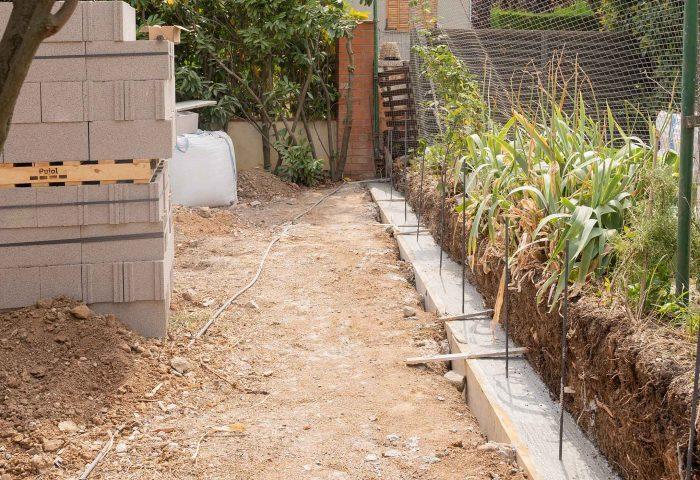 03 slider construcción muro divisor malla torsion operario vivienda particular ingrup estudio diseno construccion retail granollers barcelona